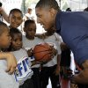NBA Draft prospect Bradley Beal, right, talks to youngsters during an NBA fitness clinic at the Children\'s Aid Society Dunlevy Milbank Boys & Girls Club in the Harlem section of New York, Wednesday, June 27, 2012. (AP Photo/Kathy Willens)