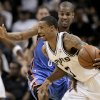 San Antonio\'s George Hill, front, drives around Oklahoma City\'s Eric Maynor during Monday\'s preseason game. AP PHOTO