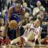 Photo - Philadelphia 76ers guard James Anderson (9), left, battles for a loose ball against Chicago Bulls guard Mike Dunleavy (34) during the first half of an NBA basketball game in Chicago, Saturday, Jan. 18, 2014. (AP Photo/Nam Y. Huh)