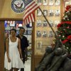 President Barack Obama and first lady Michelle Obama enter to greet marines during Christmas dinner at Anderson Hall on Marine Corps Base Hawaii in Kailua, Hawaii Friday, Dec. 25, 2009. The Obamas are in Hawaii for the holidays. (AP Photo/Alex Brandon) ORG XMIT: HIAB111