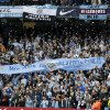 Photo - Manchester City fans hold up a banner before the English Premier League soccer match between Manchester City and West Ham at the Etihad Stadium in Manchester, England, Sunday May 11, 2014.  (AP Photo/Jon Super)