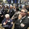 Photo - Traders gather at the post on the floor of the New York Stock Exchange that handles General Motors, Monday June 1, 2009. (AP Photo/Richard Drew)