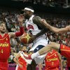 United States\' LeBron James drives between Spain\'s Pau Gasol and Rudy Fernandez during the men\'s gold medal basketball game at the 2012 Summer Olympics, Sunday, Aug. 12, 2012, in London. (AP Photo/Charles Krupa)