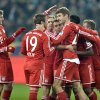 Photo - Bayern's Thomas Mueller is celebrated after scoring a penalty during the German Bundesliga soccer match between Borussia Moenchengladbach and Bayern Munich in Moenchengladbach,  Germany, Friday, Jan. 24, 2014. (AP Photo/Martin Meissner)
