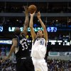 Dallas Mavericks forward Dirk Nowitzki (41), of Germany, shoots over Minnesota Timberwolves forward Dante Cunningham (33) during the second half of an NBA basketball game, Monday, Jan. 14, 2013, in Dallas. The Mavericks won 113-98. (AP Photo/Sharon Ellman)