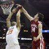 Oklahoma\'s Cade Davis (34) blocks a shot by Oklahoma State\'s Marshall Moses (33) in the second half of the college basketball game during the men\'s Big 12 Championship tournament at the Sprint Center on Wednesday, March 10, 2010, in Kansas City, Mo. Photo by Chris Landsberger, The Oklahoman