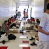 John Marshall High School math teacher Cassi Yarbrough teaches her class in the hallway to help keep the students cooler while there was no air conditioning at John Marshall High School on Friday, March 30 2012, in Oklahoma City, Oklahoma. Photo by Chris Landsberger, The Oklahoman