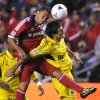 Photo -   Chicago Fire's Shejill MacDonald left, goes up for a header against Columbus Crew's Milovan Mirosevic right, during the first half of an MLS soccer game in Bridgeview, Ill., Saturday, Sept. 22, 2012. (AP Photo/Paul Beaty)