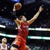 Los Angeles Clippers\' Blake Griffin (32) dunks past Phoenix Suns\' Marcin Gortat (4), of Poland, during the first half in an NBA basketball game, Thursday, Jan. 24, 2013, in Phoenix. (AP Photo/Ross D. Franklin)