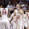 Oklahoma\'s Jelena Cerina (12), Sharane Campbell (24), Joanna McFarland, Whitney Hand (25) and Kaylon Williams (42) celebrate during a timeout in the first half of an NCAA tournament first-round women\'s college basketball game against Michigan in Norman, Okla., Sunday, March 18, 2012. (AP Photo/Sue Ogrocki)