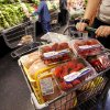 A shopper's basket is filled with groceries at Sunflower Farmers Market on Second Street in Edmond. The store opened Wednesday. Photos by Jim Beckel, The Oklahoman