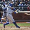 Photo - Chicago Cubs' Luis Valbuena, right, hits a single to drive home teammate Javier Baez during the fourth inning of a baseball game against the New York Mets at Citi Field, Sunday, Aug. 17, 2014, in New York. (AP Photo/John Minchillo)