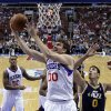 Philadelphia 76ers\' Spencer Hawes (00) goes up for a shot as Utah Jazz\'s Enes Kanter (0), of Turkey, defends in the first half of an NBA basketball game on Friday, Nov. 16, 2012, in Philadelphia. (AP Photo/Matt Slocum)