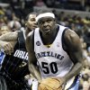 Photo -   Memphis Grizzlies' Zach Randolph (50) looks to pass as he is guarded by Orlando Magic's Earl Clark (3) during the second half of an NBA basketball game in Memphis, Tenn., Thursday, April 26, 2012. Memphis defeated Orlando 88-76. (AP Photo/Danny Johnston)