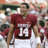 CELEBRATE, CELEBRATION: Oklahoma quarterback Sam Bradford smiles as he celebrates on the sideline after throwing his first touchdown pass of his career at Oklahoma in the first half during the University of Oklahoma Sooners (OU) college football game against the University of North Texas Mean Green (UNT) at the Gaylord Family -- Oklahoma Memorial Stadium, on Saturday, Sept. 1, 2007, in Norman, Okla. By BILL WAUGH, The Oklahoman ORG XMIT: KOD