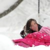 Ashton Lam, 8, comes up with a mouthful of snow while enjoying the winter weather in Staunton, Va., on Wednesday, March 6, 2012. The March snowstorm is primarily hitting a region stretching from central Virginia to the northern and western portions of the state, where snow is piling up quickly. (AP Photo/The News Leader, Mike Tripp) NO SALES