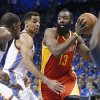 Houston Rockets guard James Harden (13) drives past Oklahoma City Thunder forward Kevin Durant, left, and guard Thabo Sefolosha during the first quarter of Game 5 of a first-round NBA basketball playoff series in Oklahoma City, Wednesday, May 1, 2013. (AP Photo/Sue Ogrocki)