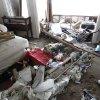 Debris is piled up in a house which was hit by a wave and flooded in Salisbury, Mass. on Saturday, Feb. 9, 2013. A behemoth storm packing hurricane-force wind gusts and blizzard conditions swept through the Northeast overnight. (AP Photo/Winslow Townson)
