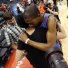 Oklahoma City\'s Kevin Durant (35) gets a hug after Game 6 of the Western Conference semifinals in the NBA playoffs between the Oklahoma City Thunder and the Los Angeles Clippers at the Staples Center in Los Angeles, Thursday, May 15, 2014. Photo by Nate Billings, The Oklahoman