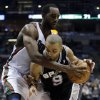 San Antonio Spurs\' Tony Parker (9) tries to drive past Milwaukee Bucks\' Luc Richard Mbah a Moute during the second half of an NBA basketball game on Wednesday, Jan. 2, 2013, in Milwaukee. (AP Photo/Morry Gash)