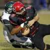 Edmond Santa Fe\'s Alvin Bazley (41) brings down Mustang quarterback Frankie Edwards (4) during a high school football game between Mustang and Edmond Santa Fe in Mustang, Okla., Friday, Sept. 28, 2012. Photo by Nate Billings, The Oklahoman