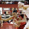 Ohio State\'s Samantha Prahalis drives past Nebraska\'s Emily Cady, right, in the first half of their NCAA college basketball game in Lincoln, Neb., Sunday, Feb. 26, 2012. (AP Photo/Nati Harnik)