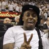 Lil Wayne watches the first half at Game 3 of the NBA Finals basketball series between the Oklahoma City Thunder and the Miami Heat, Sunday, June 17, 2012, in Miami. (AP Photo/Lynne Sladky) ORG XMIT: NBA112