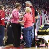 Photo - Nebraska head coach Connie Yori, center left, receives help after collapsing on the court during the NCAA women's college basketball game between Nebraska and Indiana at the Pinnacle Bank Arena on Sunday, Feb. 16, 2014, in Lincoln, Neb. (AP Photo/The Journal-Star, Morgan Spiehs) LOCAL TV OUT; KOLN-TV OUT; KGIN-TV OUT; KLKN-TV OUT.