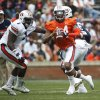 Photo - Auburn quarterback Nick Marshall (14) scrambles as defensive tackle Montravius Adams (1) watches during the first half of the A Day spring game for the NCAA college football team, Saturday, April 19, 2014 in Auburn, Ala.  (AP Photo/John Bazemore)