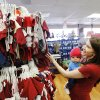 Photo - Kristen Zakariassen shops for baby clothes with her 5-month-old son, Dechlan, at Once Upon A Child in Oklahoma City. Photos by Steve Gooch, The Oklahoman
