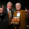 Photo -   FILE - This Feb. 29, 2012 file photo shows Texas football coach Mack Brown, left, giving the