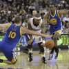 Photo - Sacramento Kings guard Isaiah Thomas, center, tries to drive between Golden State Warriors' David Lee, left, and Jordan Crawford during the third quarter of an NBA basketball game in Sacramento, Calif., Wednesday, Feb. 19, 2014. The Warriors won 101-92.(AP Photo/Rich Pedroncelli0