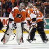 Photo - Philadelphia Flyers goalie Steve Mason, left, is replaced by Ray Emery, right, after the San Jose Sharks scored their fourth goal of an NHL hockey game during the second period on Thursday, Feb. 27, 2014, in Philadelphia. (AP Photo/Tom Mihalek)