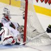 Minnesota Wild goalie Niklas Backstrom, left, of Finland, blocks a shot from Calgary Flames\' Matt Stajan during the first period of their NHL hockey game, Monday, Feb. 11, 2013, in Calgary, Alberta. (AP Photo/The Canadian Press, Jeff McIntosh)