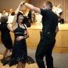 Photo -  Deputy Anthony Glover dances with Lisa Stubbs during the 18th annual Young at Heart Senior Prom. Photo by Sarah Phipps, The Oklahoman   SARAH PHIPPS -