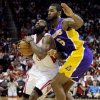 Houston Rockets\' James Harden (13) is fouled by Los Angeles Lakers\' Earl Clark (6) in the second half of an NBA basketball game, Tuesday, Dec. 4, 2012, in Houston. (AP Photo/Pat Sullivan)