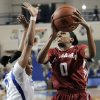 Photo - Alabama's Daisha Simmons (0) shoots near Kentucky's Bria Goss during the second half of an NCAA college basketball game, Thursday, Jan. 23, 2014, in Lexington, Ky. Alabama won 57-55. Simmons led all players with 21 points. (AP Photo/James Crisp)