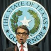 Photo - Texas Gov. Rick Perry speaks during a news conference on Saturday, Aug. 16, 2014, in Austin, Texas. Perry said Saturday that the indictment against him was an