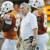 UT head coach Mack Brown walks on the field during a break in the action during a college football game between the Oklahoma State University Cowboys (OSU) and the University of Texas Longhorns (UT) at Darrell K Royal-Texas Memorial Stadium in Austin, Texas, Saturday, Oct. 15, 2011. OSU won, 38-26. Photo by Nate Billings, The Oklahoman
