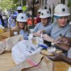 Photo - In this Aug. 14, 2014 photo, Anne White, right, and Felicia Zerilli, second from left, take a coffee break with co-workers on a construction site where they work, in New York. Zerilli, a shop steward, and White, a laborer, are two of 220 women in the 7,000 member Laborers Local 79 union. The latest federal data shows about 7.1 million Americans were employed in construction-related occupations last year and only 2.6 percent were women. (AP Photo/Julie Jacobson)