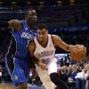 Oklahoma City\'s Thabo Sefolosha (25) drives to the basket as he is guarded by Orlando\'s Victor Oladipo (5) during the NBA basketball game between the Oklahoma City Thunder and the Orlando Magic at the Chesapeake Energy Arena, Sunday, Dec. 15, 2013. Photo by Sarah Phipps, The Oklahoman
