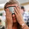 Photo -  Rebecca Tyberg, a junior at Piedmont High School, puts on her blindfold as she enters a ballroom for Dining in the dark at the University of Central Oklahoma in Edmond on Monday, Sept. 28, 2009. By John Clanton, The Oklahoman ORG XMIT: KOD