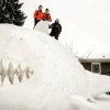 Three brothers, from left, Connor, Trevor and Austin Bartz built this 16 foot high snow shark in the front yard of their New Brighton, Minn. home, Wednesday, Jan. 1, 2014. It took them around 95 hours of work and they gathered the snow from houses in their neighborhood. (AP Photo/Star Tribune, Glen Stubbe) ST. PAUL PIONEER PRESS OUT, MINNEAPOLIS-AREA TV OUT, MAGS OUT