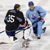 Edmonton Oilers goalie Nikolai Khabibulin, left, and Ales Hemsky talk during a break at their NHL hockey training camp in Edmonton, Alberta, Monday, Jan. 14, 2013. (AP Photo/The Canadian Press, Jason Franson)