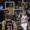 Photo - New York Knicks' Shannon Brown (26) prepares to dunk against the Miami Heat during the first half of an NBA basketball game in Miami, Thursday, Feb. 27, 2014. (AP Photo/Alan Diaz)