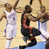 Miami\'s Dwyane Wade (3) goes to the basket between Oklahoma City\'s Russell Westbrook (0) and Oklahoma City\'s Serge Ibaka (9) during Game 2 of the NBA Finals between the Oklahoma City Thunder and the Miami Heat at Chesapeake Energy Arena in Oklahoma City, Thursday, June 14, 2012. Photo by Nate Billings, The Oklahoman