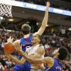 Ohio State\'s LaQuinton Ross (10) drives between Kansas defenders Jeff Withey (5) and Kevin Young (40) during the first half of an NCAA college basketball game Saturday, Dec. 22, 2012, in Columbus, Ohio. (AP Photo/Mike Munden)