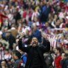 Photo - Atletico's coach Diego Simeone from Argentina, gestures towards the fans during a Spanish La Liga soccer match between Atletico Madrid and  Villarreal at the Vicente Calderon stadium in Madrid, Spain, Saturday, April 5, 2014. (AP Photo/Andres Kudacki)