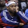 New Jersey Nets\' Vince Carter looks on from the bench during the fourth quarter as the Boston Celtics beat the Nets 105-85 in an NBA basketball game Saturday, Jan. 17, 2009 in East Rutherford, N.J. (AP Photo/Bill Kostroun) ORG XMIT: ERA108