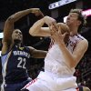 Houston Rockets\' Omer Asik (3) grabs a rebound in front of Memphis Grizzlies\' Rudy Gay (22) in the second half of an NBA basketball game on Saturday, Dec. 22, 2012, in Houston. The Rockets won 121-96. (AP Photo/Pat Sullivan)